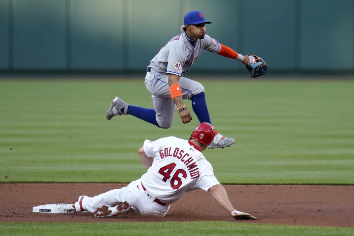 St. Louis Cardinals' Paul Goldschmidt (46) is out at second as New York Mets shortstop Francisco Lindor turns the double play during the first inning of a baseball game Monday, May 3, 2021, in St. Louis. The Cardinals' Nolan Arenado was out at first. (AP Photo/Jeff Roberson)