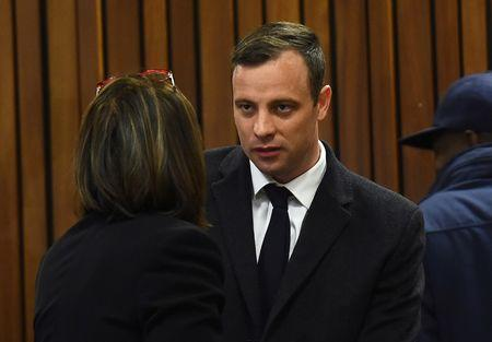 FILE PHOTO: Olympic and Paralympic track star Oscar Pistorius speaks with his legal team ahead of his sentence hearing at the North Gauteng High Court in Pretoria, South Africa, July 6, 2016. REUTERS/Masi Losi/Pool/Files