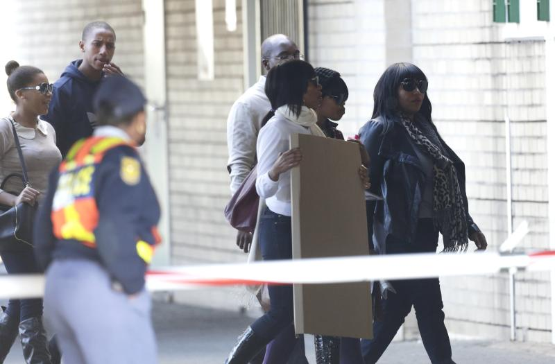 Nelson Mandela's granddaughter Zaziwe Diamini Manaway, right, arrives with other relatives at the Mediclinic Heart Hospital where former South African President Nelson Mandela is being treated in Pretoria, South Africa, Wednesday, July 3, 2013. Former president Nelson Mandela remained in a critical condition on Wednesday. (AP Photo/Markus Schreiber)