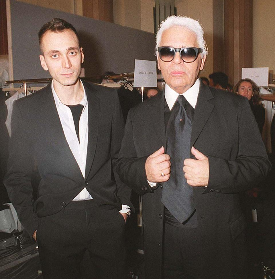 <p>Here, Karl Lagerfeld is photographed alongside Hedi Slimane at the Christian Dior Catwalk AW 01/02 show in Paris. The designer reportedly lost six stone, as he wanted to wear one of Slimane's iconic suits. <em>[Photo: Getty]</em> </p>
