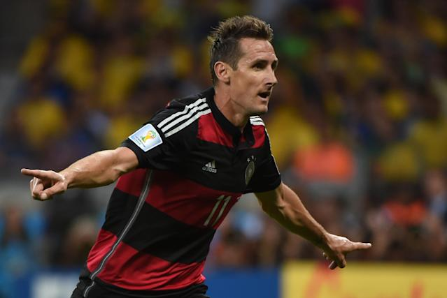 Germany's forward Miroslav Klose reacts after scoring during the semi-final football match between Brazil and Germany at The Mineirao Stadium in Belo Horizonte on July 8, 2014, during the 2014 FIFA World Cup (AFP Photo/Pedro Ugarte)