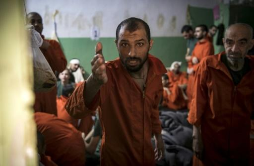 Men suspected of being affiliated with the Islamic State group gather in a prison cell in the northeastern Syrian city of Hasakeh in October 2019