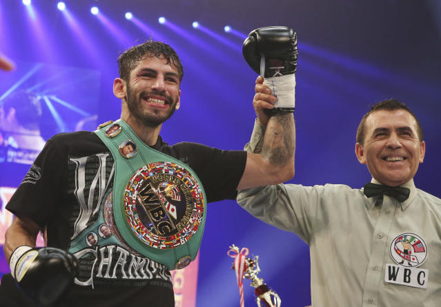 FILE - In this Dec. 30, 2014 file photo, Jorge Linares of Venezuela celebrates after defeating Javier Prieto of Mexico during their 12-round scheduled vacant WBC Light weight title bout in Tokyo. Linares will fight Vasyl Lomachenko, of Ukraine, Saturday, May 12, 2018, for Linares' WBA lightweight championship in New York. (AP Photo/Koji Sasahara, File)