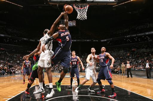 BROOKLYN, NY - MARCH 17: Josh Smith #5 of the Atlanta Hawks reaches for a rebound against Reggie Evans #30 of the Brooklyn Nets on March 17, 2013 at the Barclays Center in the Brooklyn borough of New York City. (Photo by Nathaniel S. Butler/NBAE via Getty Images)