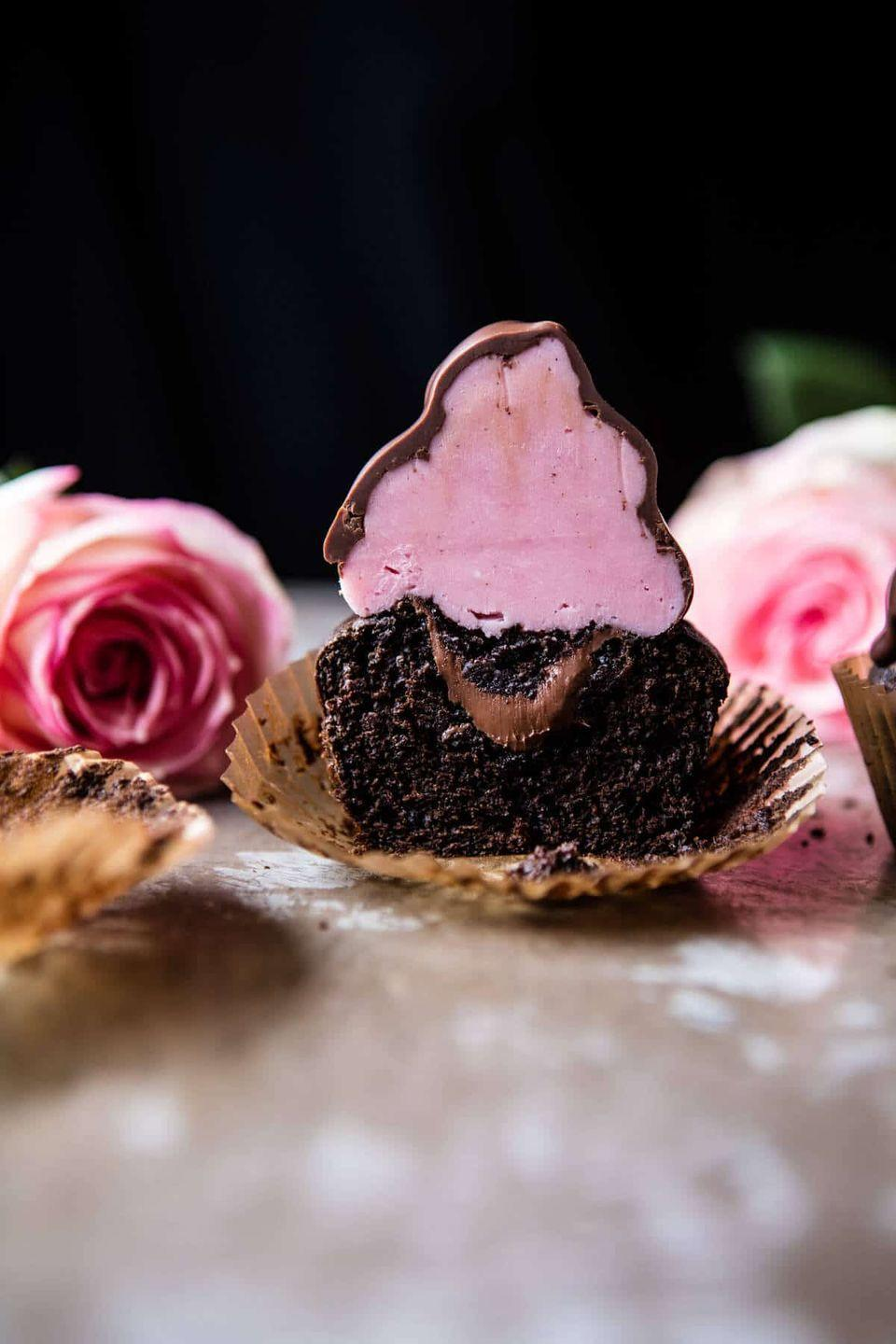 """<p>Vanilla buttercream is piped high on a chocolate cupcake and then covered in a chocolate candy coating. </p><p><strong>Get the recipe at <a href=""""https://www.halfbakedharvest.com/valentines-surprise-chocolate-high-hat-cupcakes/"""" rel=""""nofollow noopener"""" target=""""_blank"""" data-ylk=""""slk:Half Baked Harvest"""" class=""""link rapid-noclick-resp"""">Half Baked Harvest</a>.</strong></p><p><strong><a class=""""link rapid-noclick-resp"""" href=""""https://go.redirectingat.com?id=74968X1596630&url=https%3A%2F%2Fwww.walmart.com%2Fsearch%2F%3Fquery%3Dcupcake%2Bstand&sref=https%3A%2F%2Fwww.thepioneerwoman.com%2Ffood-cooking%2Fmeals-menus%2Fg35139389%2Fvalentines-day-cupcake-ideas%2F"""" rel=""""nofollow noopener"""" target=""""_blank"""" data-ylk=""""slk:SHOP CUPCAKE STANDS"""">SHOP CUPCAKE STANDS</a><br></strong></p>"""
