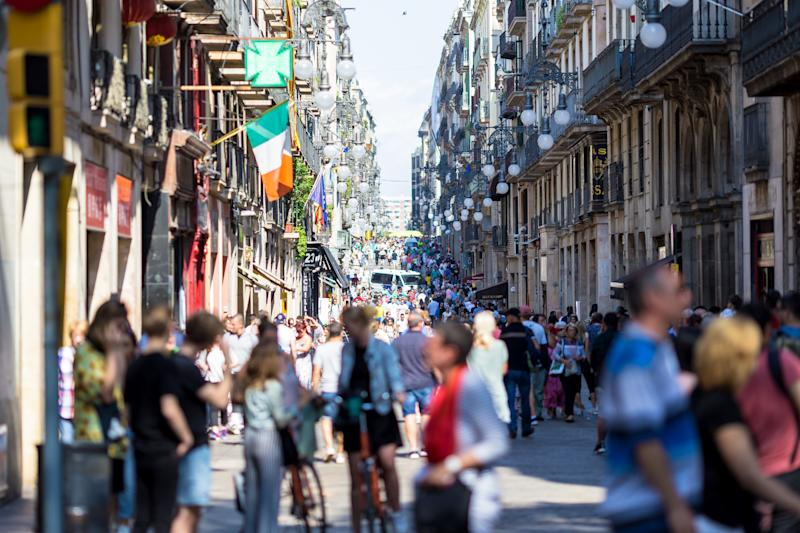 Day scene at Las Ramblas close to Plaça de Catalunya at rush hour, Barcelona, Spain. Locals and tourists walk along Las Ramblas as life returns to normal following Thursday's terrorist attack, on August 19, 2017 in Barcelona, Spain.