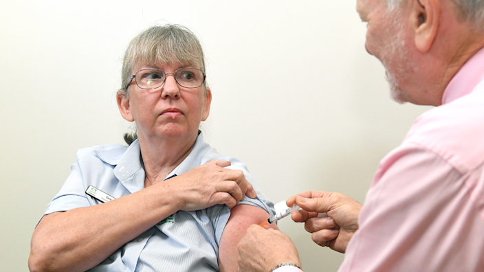 A healthcare workers gets a jab in Brisbane