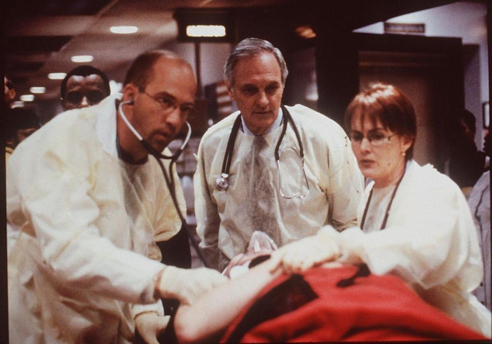<p>Alan Alda's (center) stint on <em>ER </em>in the show's fifth season may have reminded him of his time as a war doctor in <em>M.A.S.H.</em>, unfortunately the actor's return to the silver screen was only a five episode arc. </p>