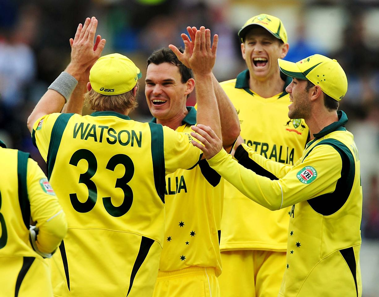 Australia's Clint McKay celebrates after bowling New Zealand's Luke Ronchi caught Shane Watson for 14 during the ICC Champions Trophy match at Edgbaston, Birmingham.