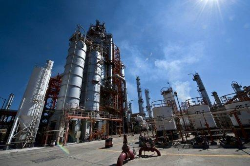 View of the structures used to precess oil at Mexican state-owned petroleum company PEMEX refinery in Tula, Hidalgo state, Mexico on March 8, 2011. Mexico's President Enrique Pena Nieto proposed a constitutional reform Monday that would allow the state oil monopoly Pemex to partner with private energy companies to explore for and produce oil