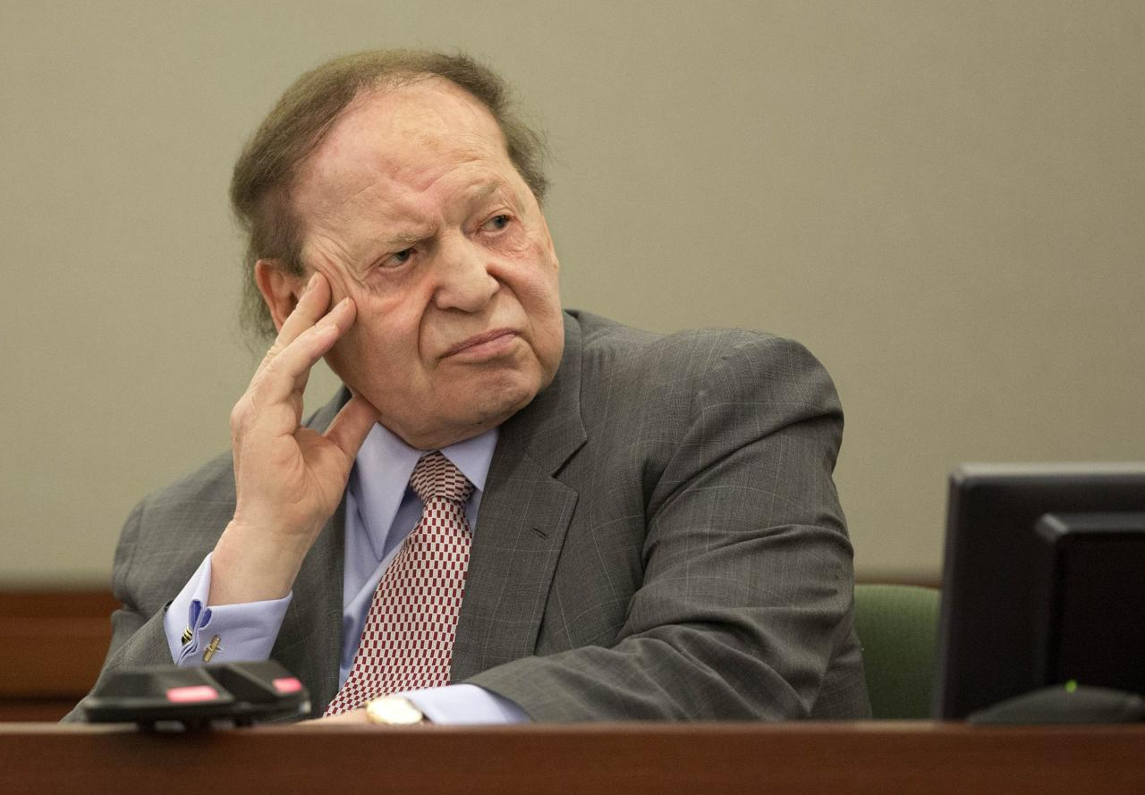 FILE - In this Friday, April 5, 2013, file photo, Las Vegas Sands Corp. CEO Sheldon Adelson testifies in Clark County district court in Las Vegas. The billionaire casino mogul has lost a defamation lawsuit against the National Jewish Democratic Council. He asked for $60 million in damages, arguing the council libeled him by saying his political contributions were sullied by links to prostitution. A federal judge in Manhattan on Monday, Sept. 30, 2013 found that the council's speech was protected. (AP Photo/Julie Jacobson, File)