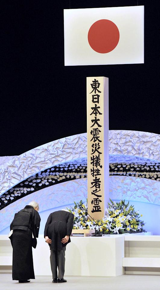 Japanese Emperor Akihito, right, and Empress Michiko bow during the national memorial service for the victims of the March 11, 2011, earthquake and tsunami in Tokyo Sunday, March 11, 2012. Through silence and prayers, people across Japan on Sunday remembered the massive disaster that struck the nation one year ago, killing just over 19,000 people and unleashing the world's worst nuclear crisis in a quarter century. (AP Photo/Japan POOL) JAPAN OUT