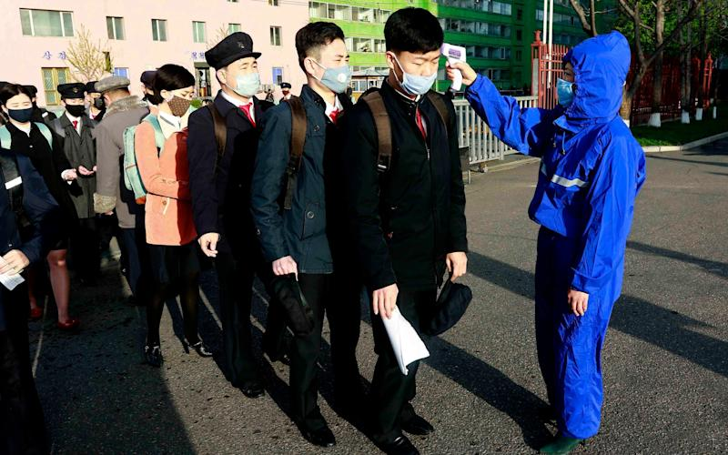 Students in Pyongyang have their temperatures checked  - Jon Chol Jin/AP