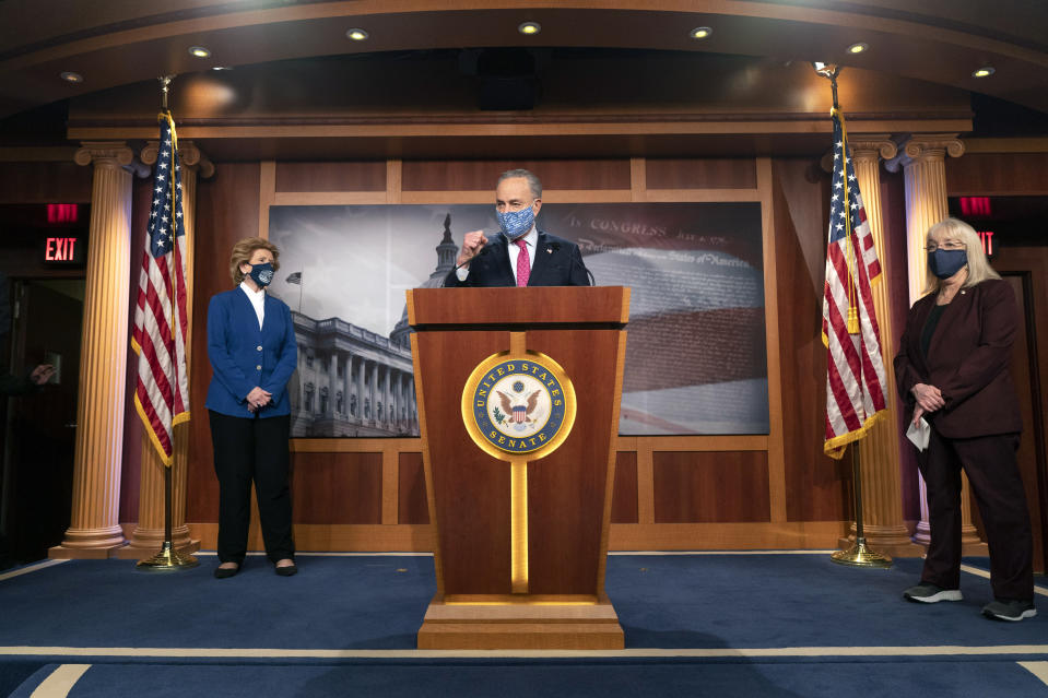 Senate Majority Leader Chuck Schumer of N.Y., center, speaks during a news conference with Sen. Debbie Stabenow, D-Mich., left, and Sen. Patty Murray, D-Wash., Tuesday, Jan. 26, 2021, on Capitol Hill in Washington. (AP Photo/Jacquelyn Martin)