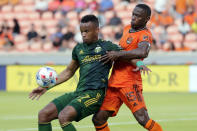 Portland Timbers forward Jeremy Ebobisse (17) blocks out Houston Dynamo defender Maynor Figueroa (15) as he brings the ball down during the first half of an MLS soccer match Wednesday, June 23, 2021, in Houston. (AP Photo/Michael Wyke)