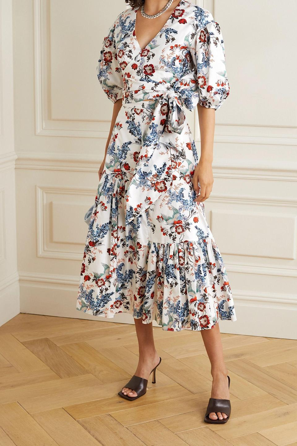 """<p><strong>ERDEM</strong></p><p>net-a-porter.com</p><p><strong>$495.00</strong></p><p><a href=""""https://go.redirectingat.com?id=74968X1596630&url=https%3A%2F%2Fwww.net-a-porter.com%2Fen-us%2Fshop%2Fproduct%2Ferdem%2Fclothing%2Fblouses%2Fcyllene-cropped-floral-print-cotton-poplin-wrap-top%2F8008779905312828&sref=https%3A%2F%2Fwww.cosmopolitan.com%2Fstyle-beauty%2Ffashion%2Fg36618322%2Fnet-a-porter-spring-sale-2021%2F"""" rel=""""nofollow noopener"""" target=""""_blank"""" data-ylk=""""slk:Shop Now"""" class=""""link rapid-noclick-resp"""">Shop Now</a></p><p>You can easily dress this shirt up or down with a pair of jeans or a luxe midi!</p>"""