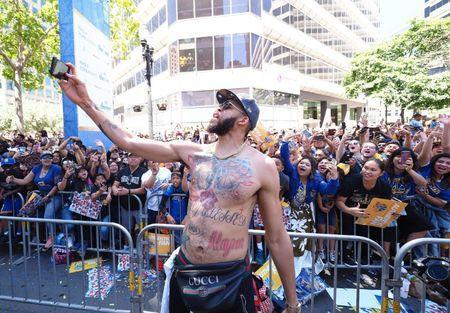 Jun 12, 2018; Oakland, CA, USA; Golden State Warriors center JaVale McGee (1) takes a selfie with fans during the championship parade in downtown Oakland. Mandatory Credit: Kelley L Cox-USA TODAY Sports