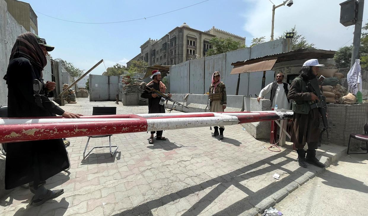 Members of Taliban forces keep watch at a checkpoint in Kabul on Tuesday.