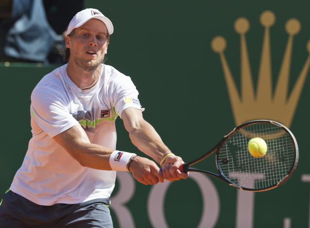 Andreas Seppi of Italy, returns the ball to Rafael Nadal of Spain during their third round match of the Monte Carlo Tennis Masters tournament in Monaco, Thursday, April 17, 2014. Nadal won 6-1 6-3. (AP Photo/Michel Euler)
