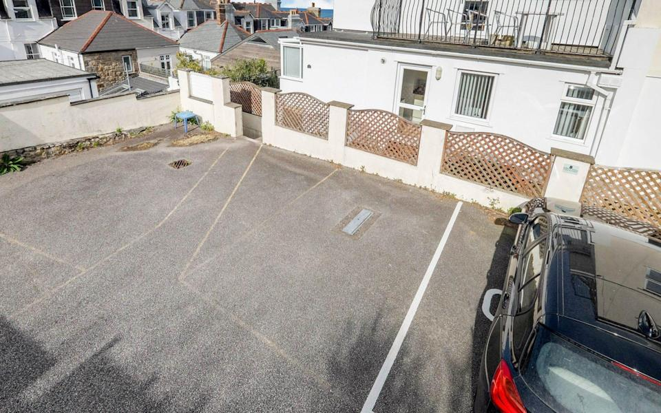 The spot (to the left of the car) sold for £45,000 - Miller Countrywide/Solent News & Photo Agency
