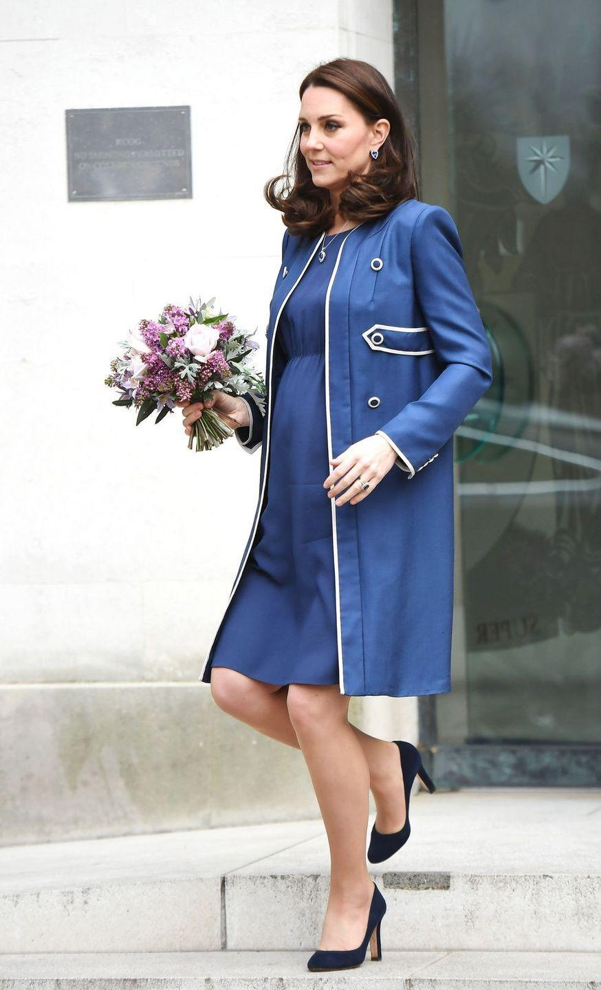 <p>In a lined Jenny Packham blue coat and dress and Jimmy Choo navy heels while visiting the Royal College of Obstetricians and Gynaecologists in London.</p>