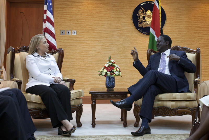 U.S. Secretary of State Hillary Rodham Clinton, left, meets with Kenya's Prime Minister Raila Odinga at the Prime Ministers office in Nairobi, Kenya, on Saturday, Aug. 4, 2012. (AP Photo/Jacquelyn Martin, Pool)