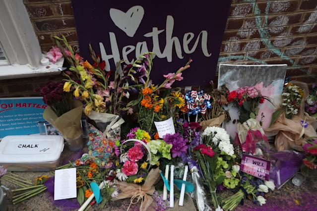 "<p>Flowers and messages are left at a memorial to Heather Heyer ahead of the one year anniversary of 2017 Charlottesville ""Unite the Right"" protests, in Charlottesville, Va., Aug. 11, 2018. (Photo: Jim Urquhart/Reuters) </p>"