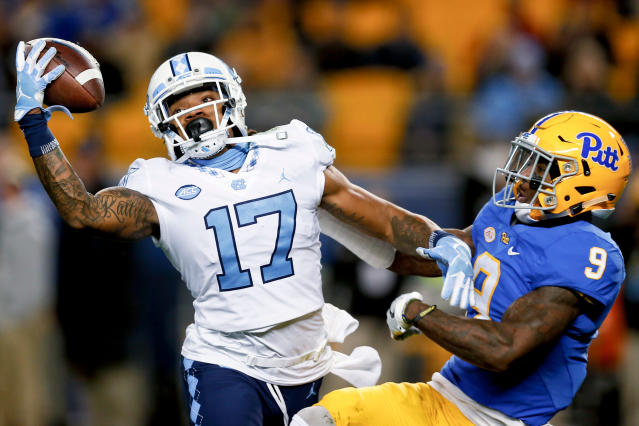 FILE - In this Nov. 9, 2017, file photo, North Carolina wide receiver Anthony Ratliff-Williams (17) makes a catch as Pittsburgh defensive back Jordan Whitehead (9) defends during the first quarter of an NCAA college football game, in Pittsburgh. Ratliff-Williams is one of the players poised to break out once ACC teams begin preseason camp over the summer. (AP Photo/Keith Srakocic, File)