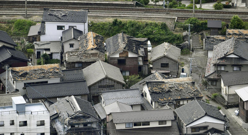 This aerial view shows damaged roof tiles of residential houses in Tsuruoka, Yamagata prefecture, northwestern Japan, Wednesday, June 19, 2019, after an earthquake. The powerful earthquake jolted northwestern Japan late Tuesday, prompting officials to issue a tsunami warning along the coast which was lifted about 2 ½ hours later. Tsuruoka city officials were helping coastal residents evacuate to higher ground as a precaution. (Kyodo News via AP)