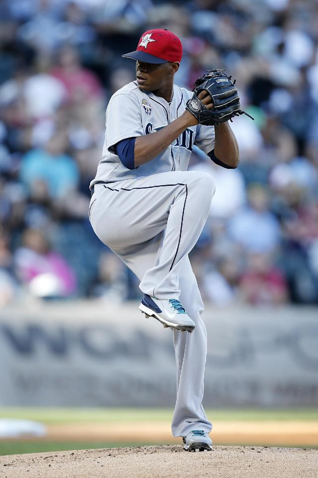 Seattle Mariners starting pitcher Roenis Elias delivers against the Chicago White Sox during the first inning of a baseball game on Friday, July 4, 2014, in Chicago. (AP Photo/Andrew A. Nelles)