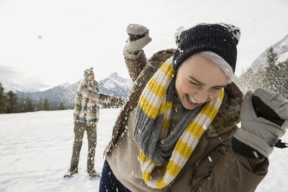 <p>With a flask of your favorite beverage tucked into a coat pocket, head outside and challenge each other to a snow tussle. Every time someone gets hit, they take a swig. Best snow day ever.</p>