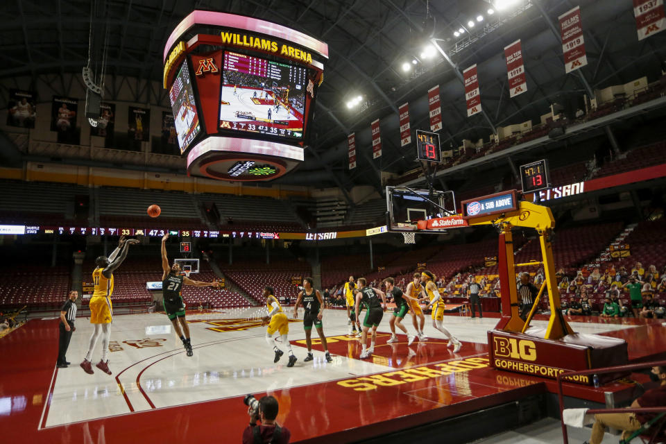 Minnesota guard Both Gach (11) shoots from three-point territory against North Dakota guard Ethan Igbanugo (21) in the first half of an NCAA college basketball game with no fans in Williams Arena on Friday, Dec. 4, 2020, in Minneapolis. (AP Photo/Bruce Kluckhohn)