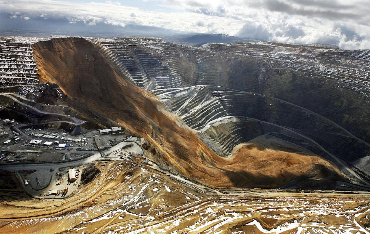 FILE - This April 11, 2013, file photo, shows the Kennecott Utah Copper Bingham Canyon Mine after a landslide in Bingham Canyon, Utah. The avalanche near Salt Lake City last year that carried enough rock, dirt and debris to bury New York's Central Park under 66 feet of rubble was North America's largest such disaster in modern history, according to University of Utah scientists. The April 2013 rockslide sent 165 million tons of debris into a nearly mile-deep pit where it cracked bedrock and triggered unprecedented earthquakes, the researchers said in a newly published study. (AP Photo/The Deseret News, Ravell Call, File) SALT LAKE TRIBUNE OUT; MAGS OUT