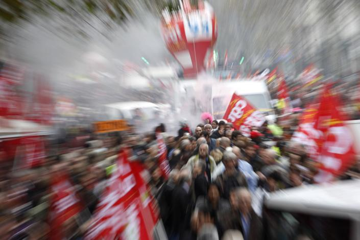 Workers of the public and private sectors demonstrate in Paris, Tuesday, Oct. 11, 2011, during a national day of strike against government austerity measures. President Nicolas Sarkozy's conservative government says the cost-cutting measures are essential to reducing the country's debts and allowing France to remain a pillar of the troubled eurozone. (AP Photo/Thibault Camus)