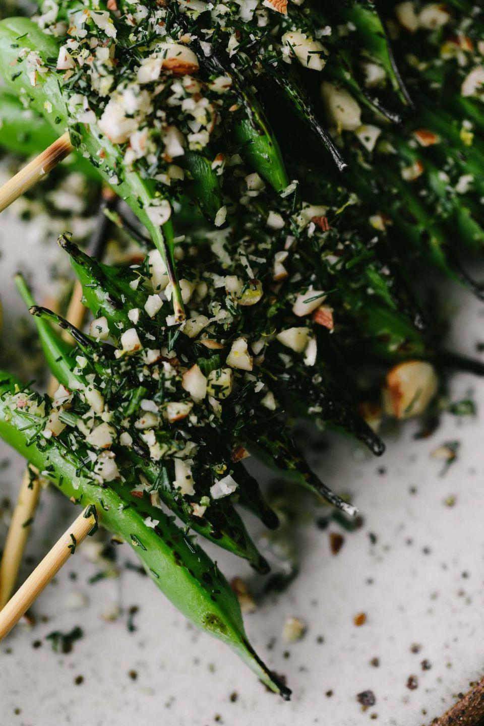 """<p>The hazelnut-dill crumb coating is beyond insane. </p><p>Get the <a href=""""https://naturallyella.com/grilled-snap-peas/"""" rel=""""nofollow noopener"""" target=""""_blank"""" data-ylk=""""slk:Grilled Snap Peas"""" class=""""link rapid-noclick-resp"""">Grilled Snap Peas</a> recipe.</p><p>Recipe from <a href=""""https://naturallyella.com/"""" rel=""""nofollow noopener"""" target=""""_blank"""" data-ylk=""""slk:Naturally Ella"""" class=""""link rapid-noclick-resp"""">Naturally Ella</a>.</p>"""
