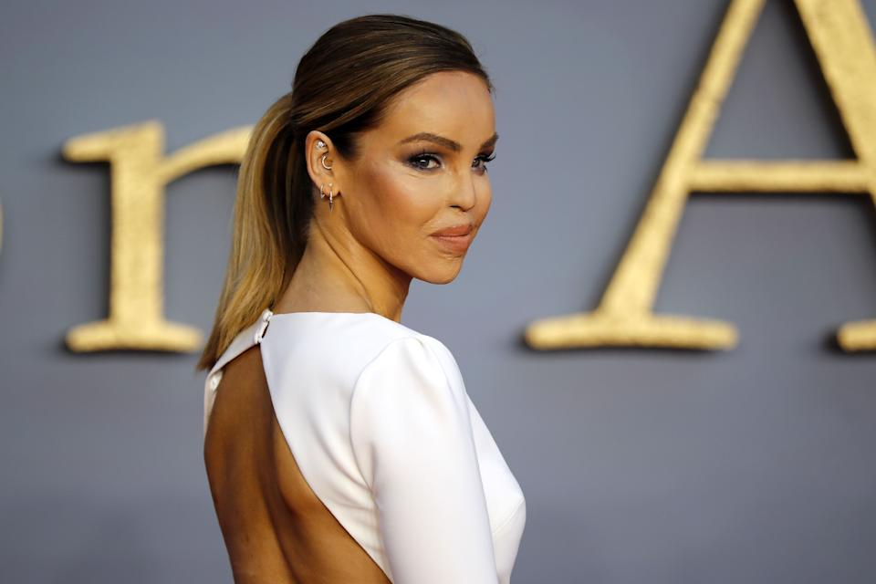 "British TV presenter Katie Piper poses on the red carpet upon arrival for the world premiere of the film ""Downton Abbey"" in London on Spetember 9, 2019. (Photo by Tolga AKMEN / AFP)        (Photo credit should read TOLGA AKMEN/AFP/Getty Images)"
