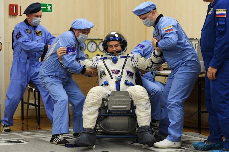Russian cosmonaut Alexey Ovchinin's spacesuit was tested before the launch (AFP Photo/Kirill KUDRYAVTSEV)