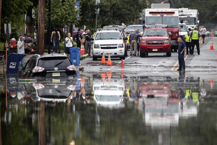 Officials and residents gather on the edge of the floodwaters submerging Broadway in Westville, N.J. Thursday, June 20, 2019. Severe storms containing heavy rains and strong winds spurred flooding across southern New Jersey, disrupting travel and damaging some property. (Photo: Matt Rourke/AP)