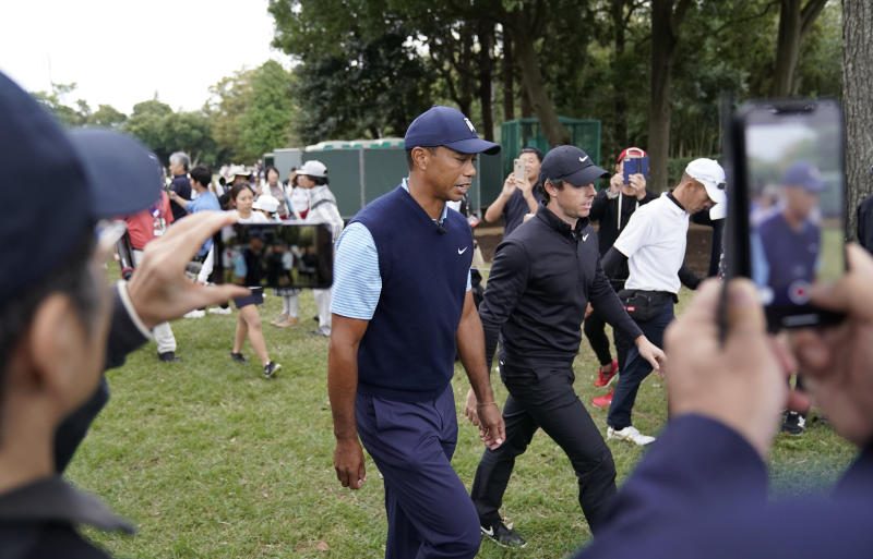 Tiger Woods of the United States, center left, and Rory McIlroy of Northern Ireland, center right, walk during the Challenge: Japan Skins event ahead of the Zozo Championship PGA Tour at Accordia Golf Narashino C.C. in Inzai, east of Tokyo, Monday, Oct. 21, 2019. (AP Photo/Lee Jin-man)