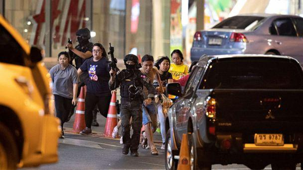 PHOTO: Armed commando soldier escort people out of Terminal 21 shopping mall in Nakhon Ratchasima, Thailand on Feb. 9, 2020. A soldier is the suspected shooter responsible for a mass shooting at Terminal 21. (Sakchai Lalitkanjanakul/AP)