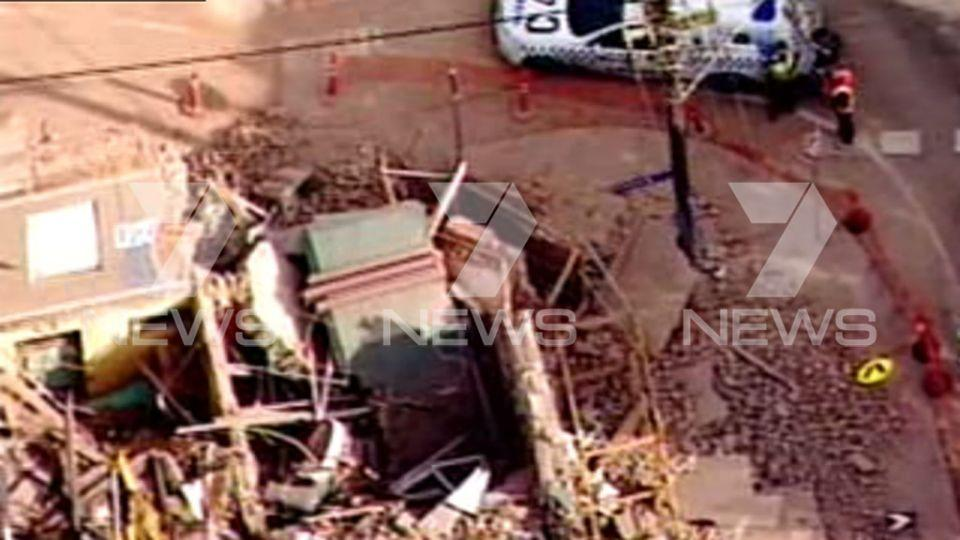 Police attend the site at a building wall collapse. Picture: 7 News