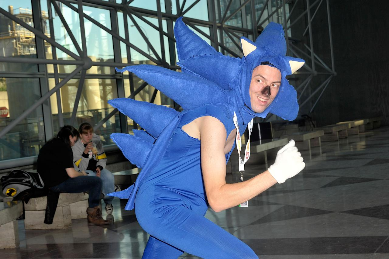 A Comic Con attendee wearing a Sonic the Hedgehog costume poses during the 2012 New York Comic Con at the Javits Center on October 11, 2012 in New York City.  (Photo by Daniel Zuchnik/Getty Images)