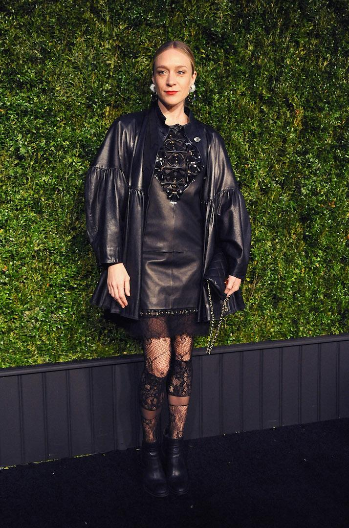 Ever the style muse, Chloë Sevigny demonstrated how to layer leather in a mini dress, boxy jacket and lace tights at the Chanel Tribeca Film Festival Artists Dinner. A lick of red lipstick completed the red carpet ensemble. <em>[Photo: Getty]</em>