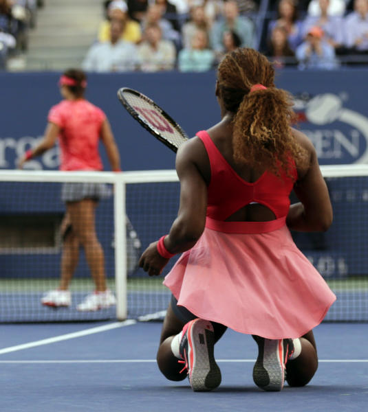 Serena Williams reacts after losing a point to Li Na, of China, during the semifinals of the 2013 U.S. Open tennis tournament, Friday, Sept. 6, 2013, in New York. (AP Photo/Charles Krupa)