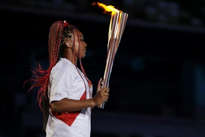 Japanese-Haitian tennis star Naomi Osaka lit the Olympic cauldron in the crowning moment of the opening ceremony