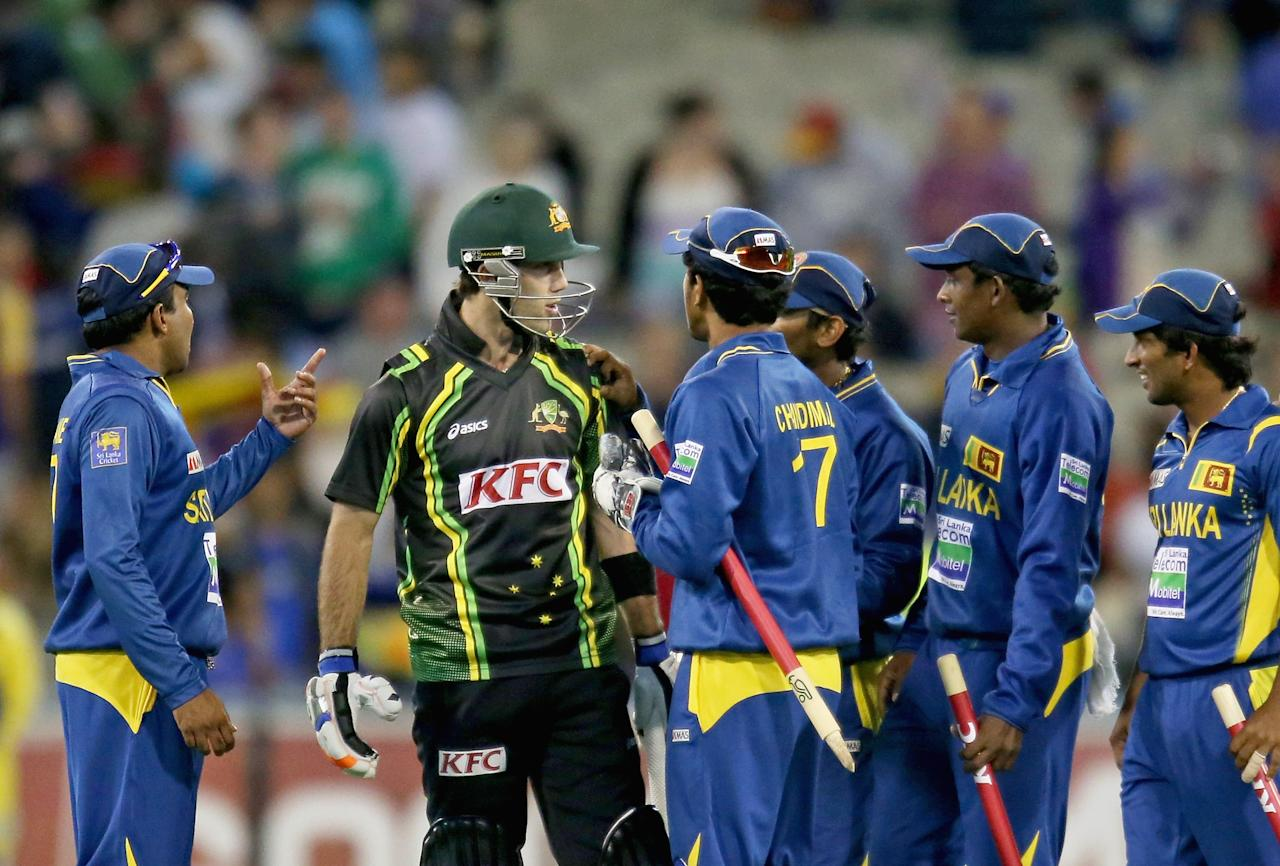 MELBOURNE, AUSTRALIA - JANUARY 28:  Glenn Maxwell of Australia has words with the Sri Lankan team after the final ball of the game during game two of the Twenty20 International series between Australia and Sri Lanka at the Melbourne Cricket Ground on January 28, 2013 in Melbourne, Australia.  (Photo by Scott Barbour/Getty Images)