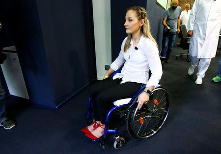 <p>Germany's Olympic and world sprint cycling champion Kristina Vogel leaves a news conference after talking to the media for the first time since being paralysed following a serious crash in training at the Unfallkrankenhaus hospital in Berlin, Germany, September 12, 2018. REUTERS/Fabrizio Bensch </p>