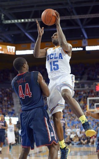UCLA forward Shabazz Muhammad, right, puts up a shot as Arizona forward Solomon Hill defends during the second half of an NCAA college basketball game, Saturday, March 2, 2013, in Los Angeles. UCLA won 74-69. (AP Photo/Mark J. Terrill)