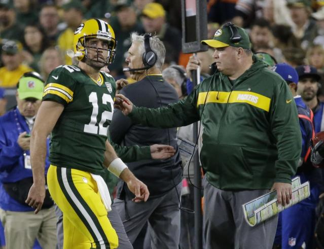 Green Bay Packers head coach Mike McCarthy looks at Aaron Rodgers as he walks off the field after injuring his leg during the first half of an NFL football game against the Chicago Bears Sunday, Sept. 9, 2018, in Green Bay, Wis. (AP Photo/Mike Roemer)