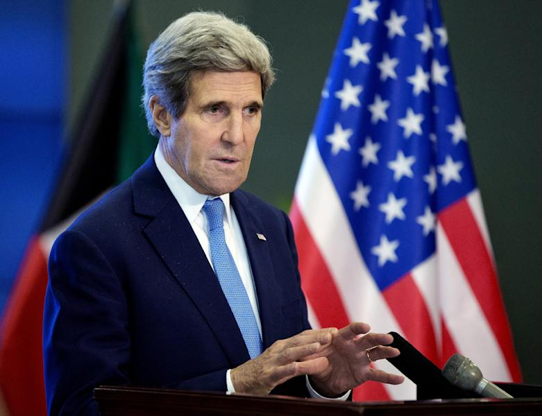 US Secretary of State John Kerry speaks during a news conference at Syria Donors' Conference at the Bayan Palace in Kuwait, Wednesday, Jan. 15, 2014. (AP Photo/Pablo Martinez Monsivais, Pool)